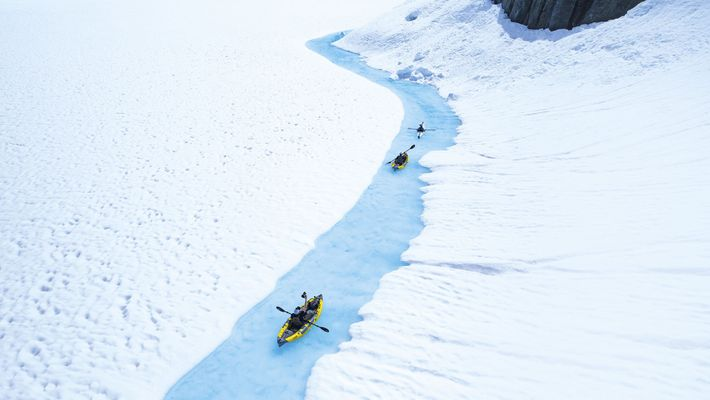 Kayaking on a semi-frozen lake, British Columbia, Canada