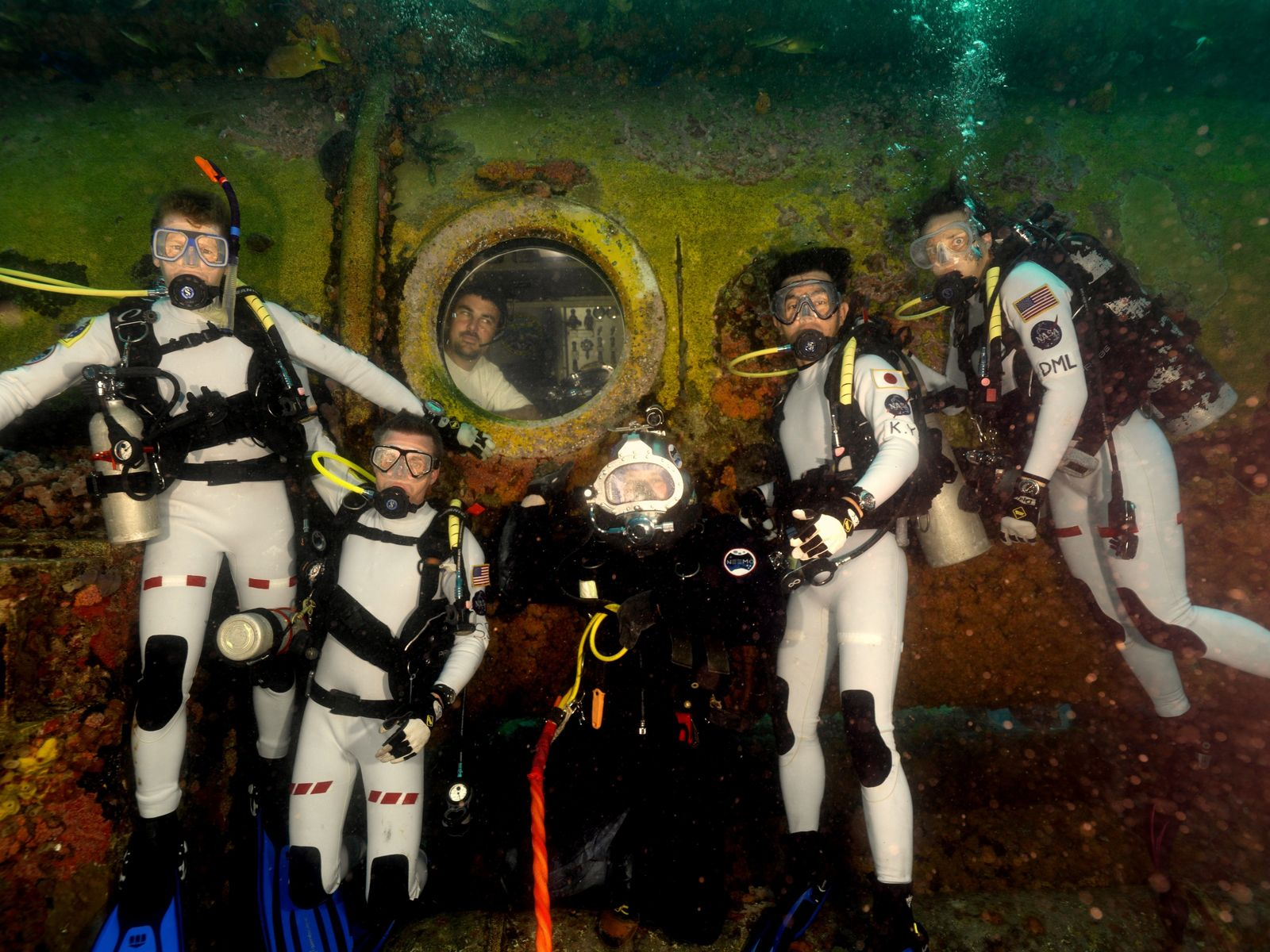 Tim Peake (left) trains underwater with fellow astronauts at the Aquarius Reef Base.