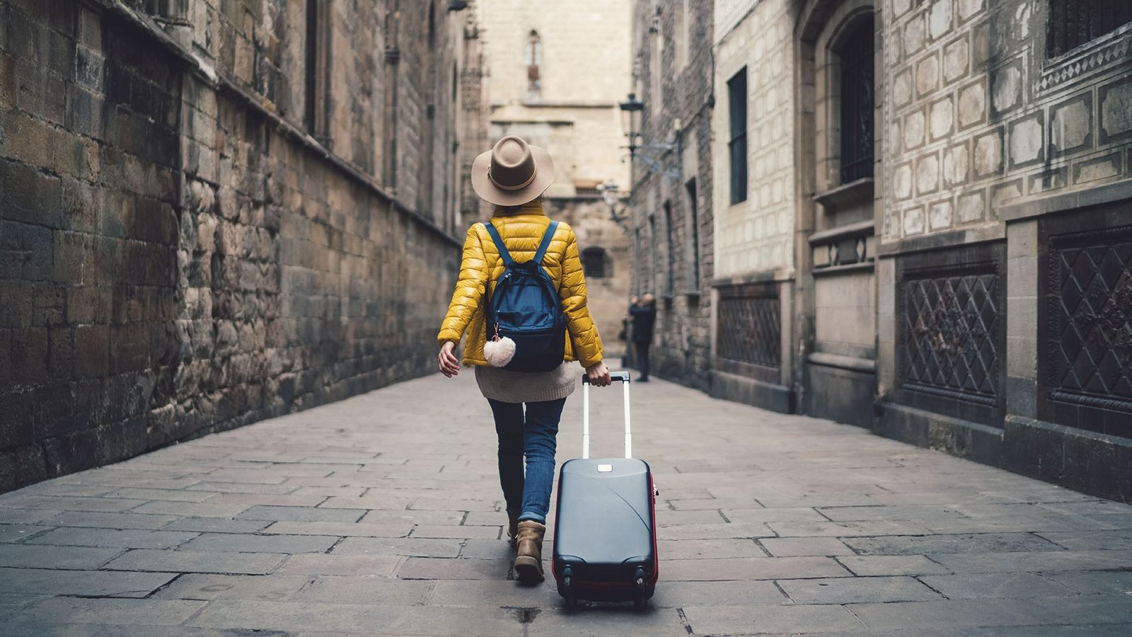 A traveller with her luggage.