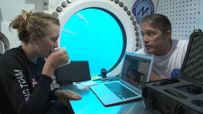 Grace enjoys a cup of tea with Fabien Cousteau, while living underwater for more than a ...