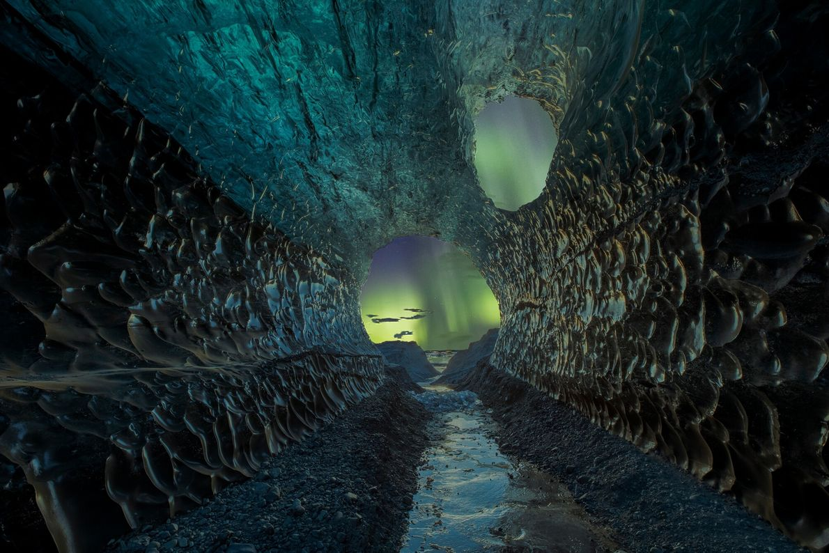 A striking shot viewed through an ice cave in Iceland, this image comprises two exposures – ...