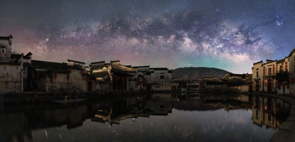 The ancient village of Hungcun with a dramatic night sky is atmospherically rendered in this image, shot ...