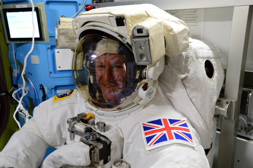 Tim Peake goes through a final check of his space suit before a space walk.