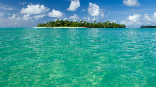 Remote motu in the lagoon at Huahine, French Polynesia