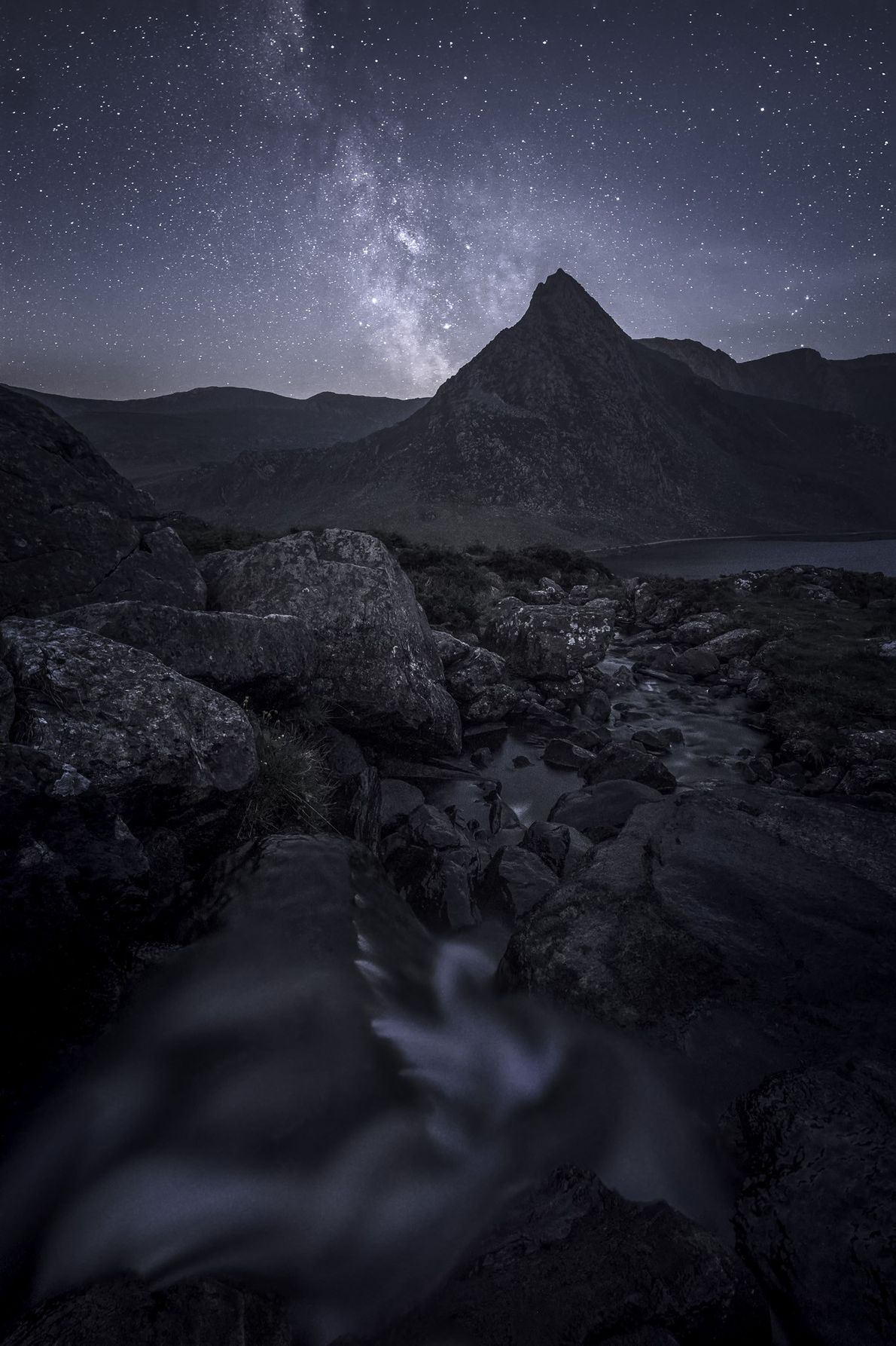 """Alyn Wallace: """"The pointed peak of Tryfan in the Snowdonia Dark Sky Reserve under the grace ..."""