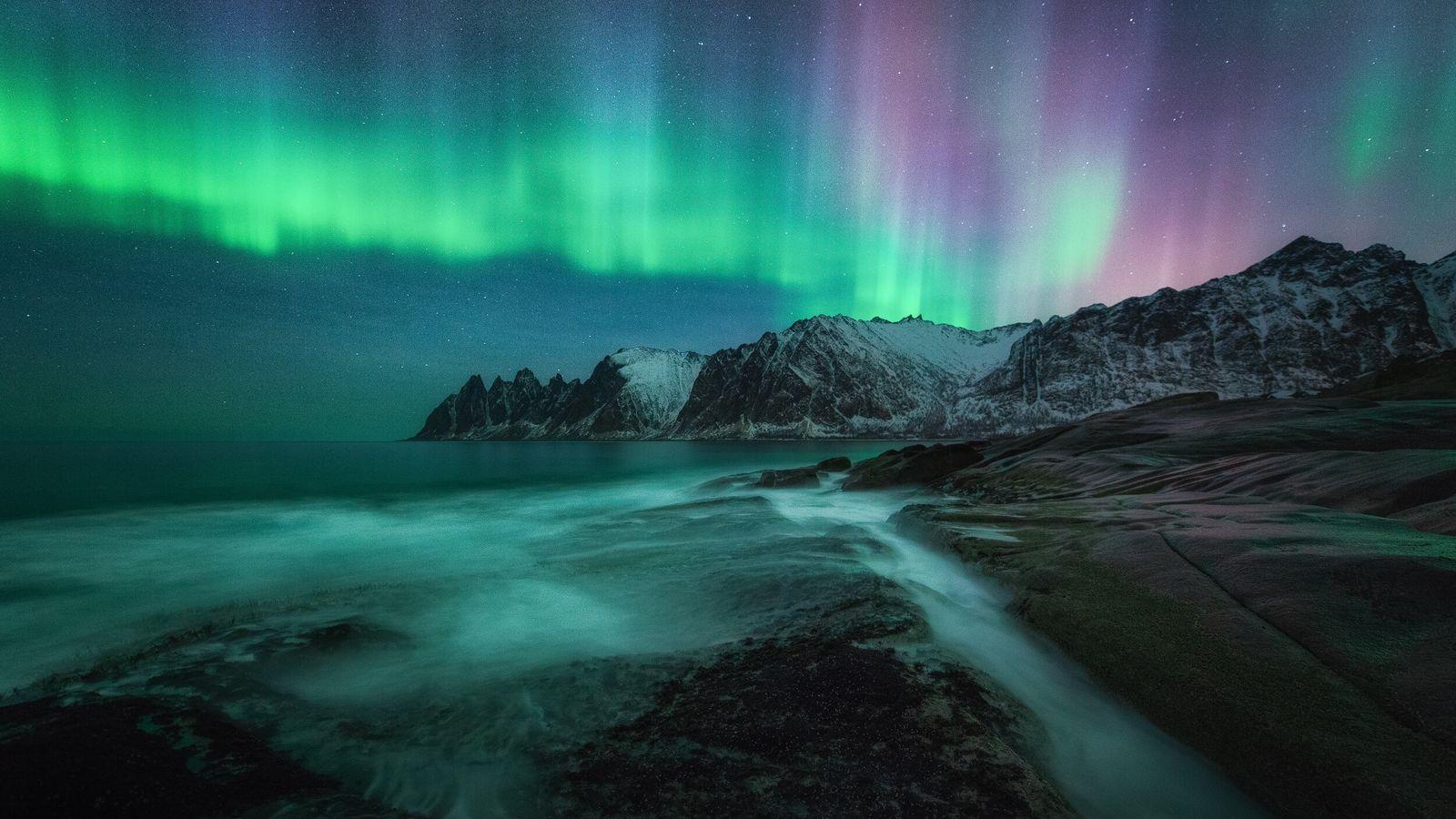 "The aurora borealis lights up Tungeneset, on Senja in the Lofoten archipelago. Stian Klo: ""That night the aurora was ..."