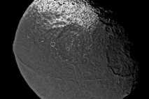Iapetus has a giant, equatorial mountain range that wraps most of the way around the moon