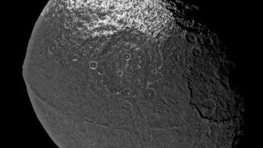 Saturn's Moon Wears the Weirdest Mountain Range in the Solar System