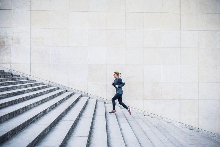 Runner running up steps