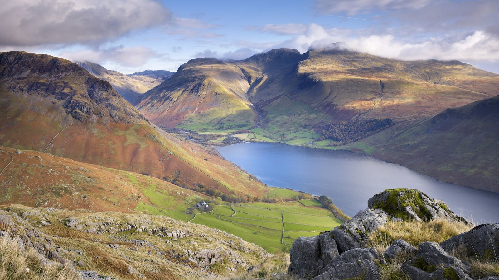 With it's summit shrouded in cloud, Scafell Pike towers over Wastwater in the Lake District.
