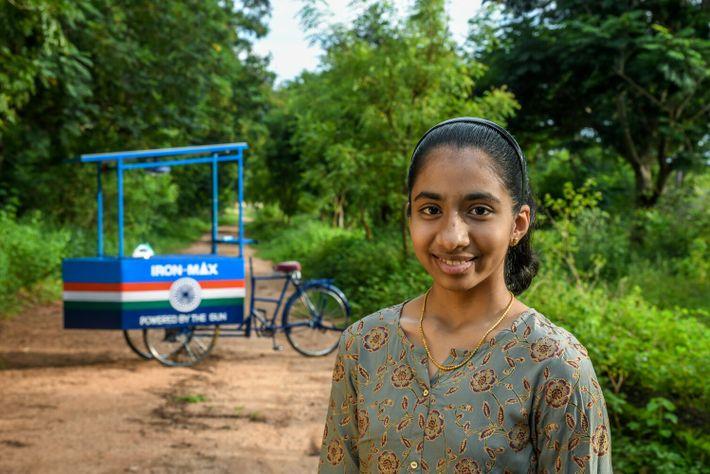 14 year-old Vinisha Umashankar, with her solar powered ironing cart.
