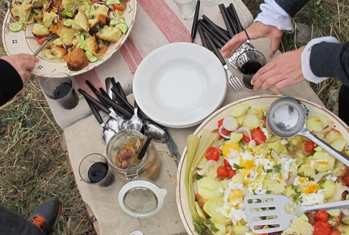 Diving into the cialledda soup after shepherding in Puglia