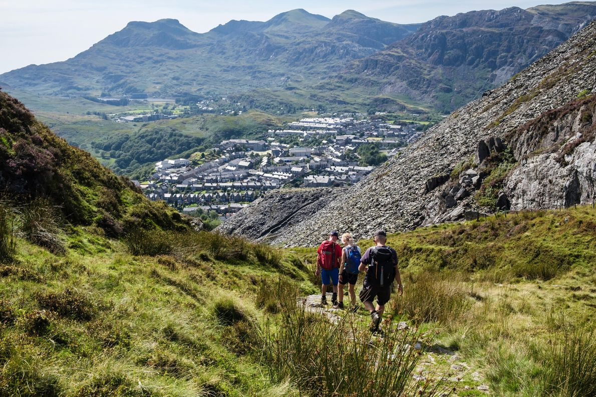 Hikers descending towards Blaenau Ffestiniog. Snowdonia National Park - which surrounds the town – offers some ...