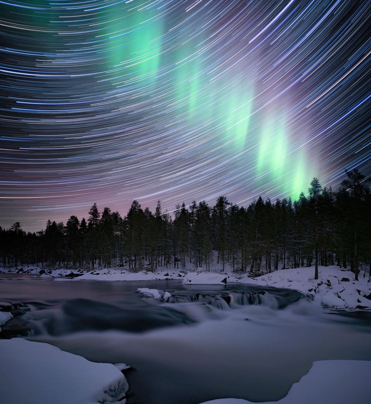A mixture of water motion, star trails and the beginning of the display of the aurora ...