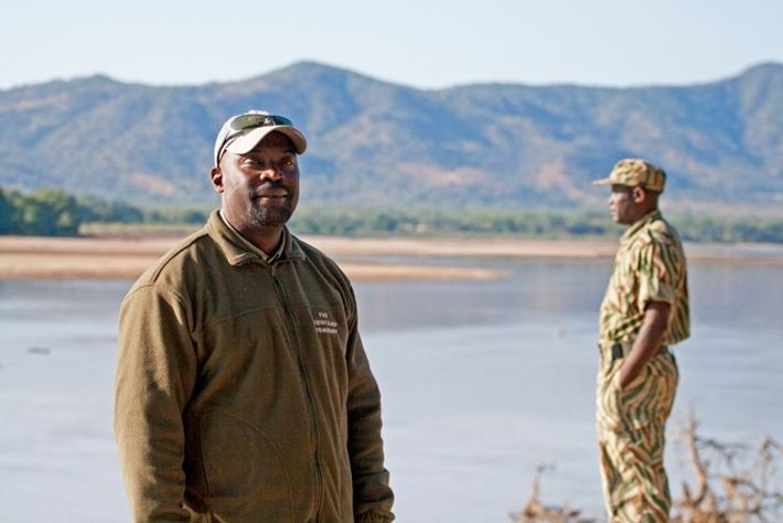 Manda Chisanga of The Bushcamp Company beside the Luangwa River, overlooking the Chindeni Hills, South Luangwa ...