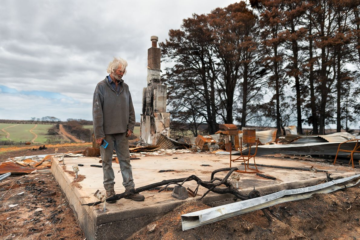 Ian Larcombe surveys the wreckage of his soldier settler home, destroyed in the fire. Describing the ...