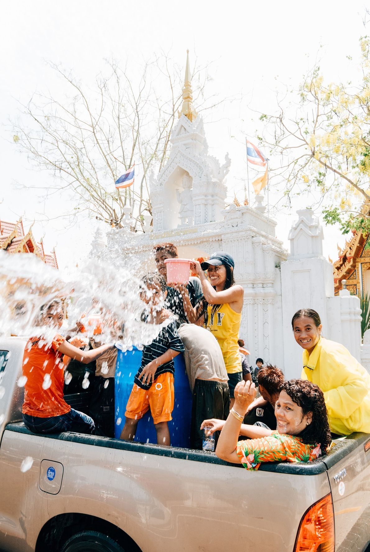 Celebrating Songkran (Thai New Year) the modern way in Nakhon Phanom, cruising the town and countryside ...
