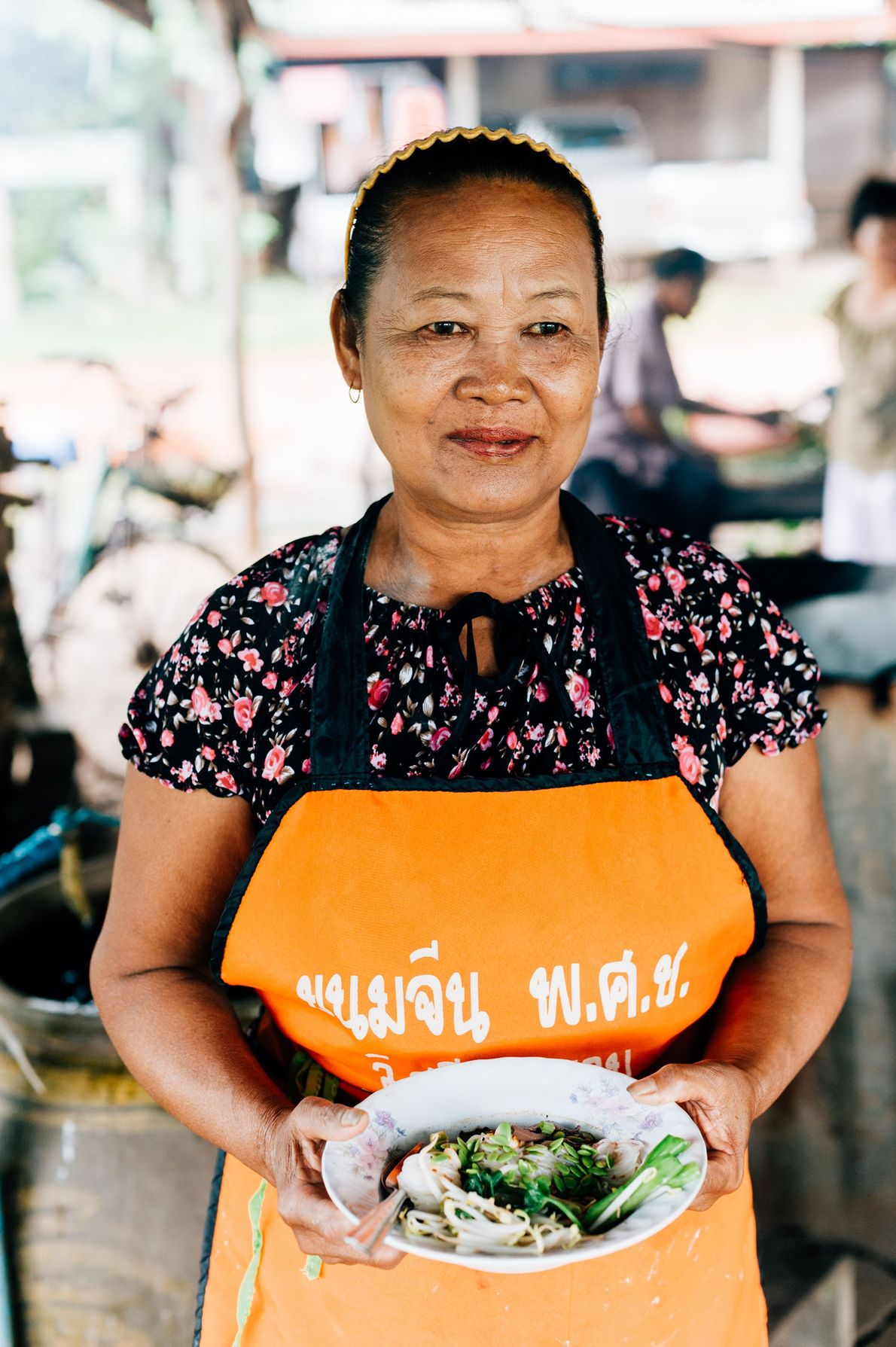 Mrs Bunrat Srihathong with a bowl of her noodles that she makes daily at her stall ...