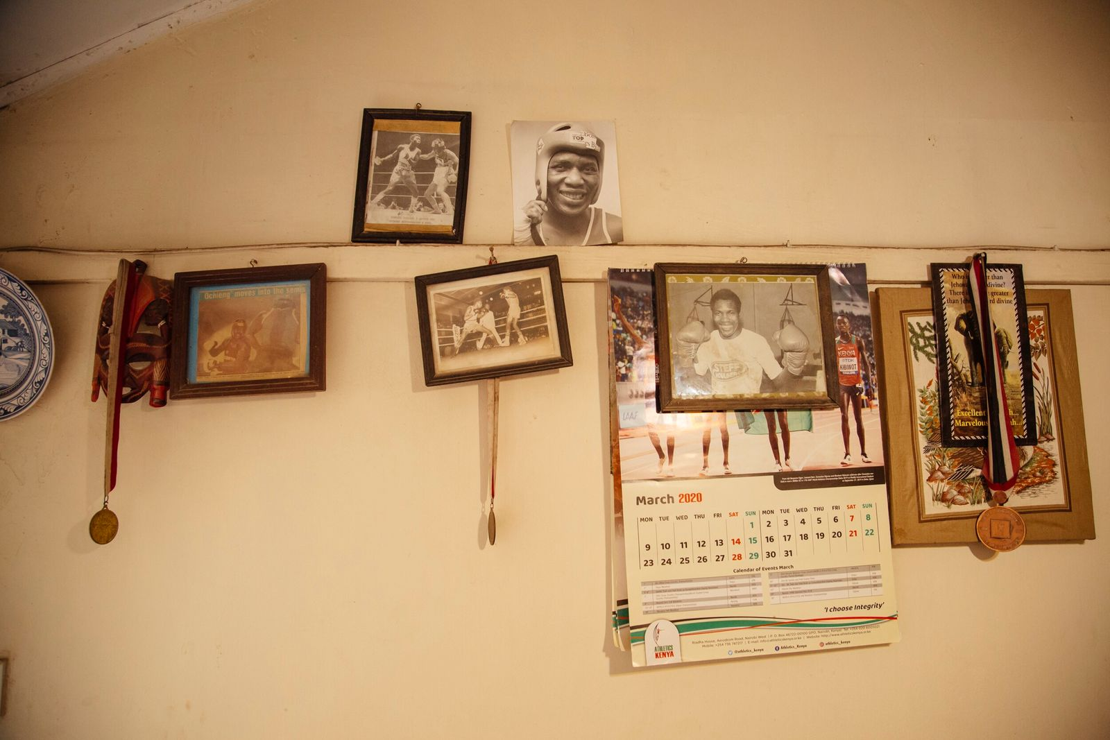 Some of Ochieng's accolades and mementos from his boxing career hang in his home. The bulk ...