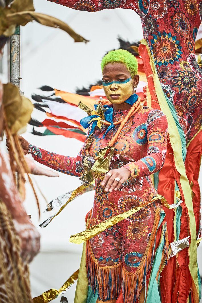 The moko jumbies celebrate West African deities — whether it's the Yoruban spirit Yemọja, a water spirit; ...