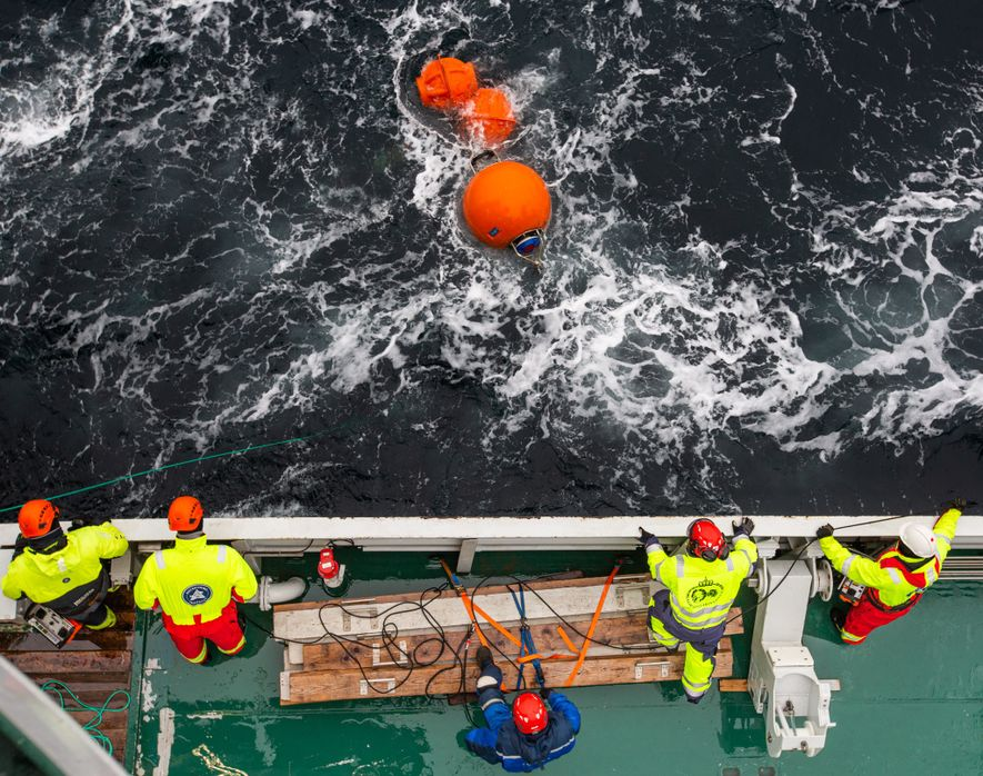 Scientists collect an instrument array from the Fram Strait.