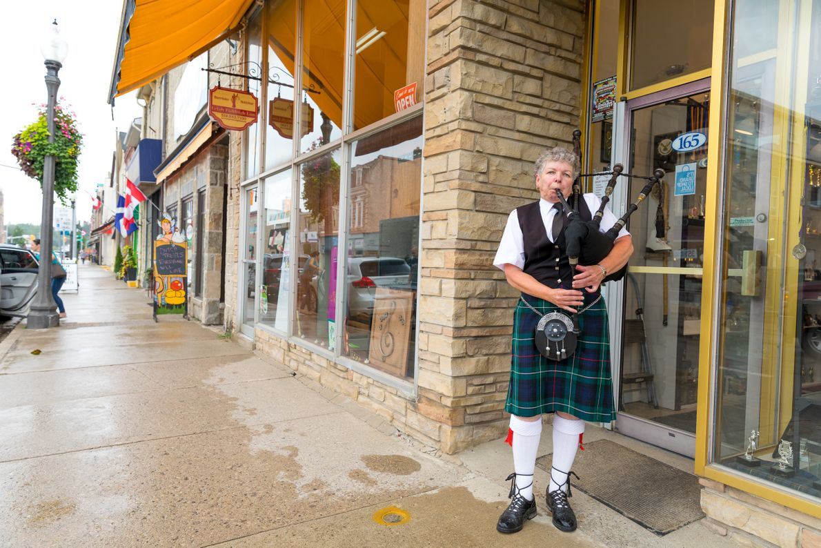 A bagpiper from the Fergus Pipe Band plays every Saturday in downtown Fergus to celebrate the ...