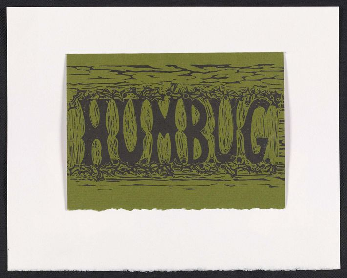 """Artist Marilyn Brownell's Dickensian Christmas message is the single word """"Humbug"""" in block print surrounded by ..."""
