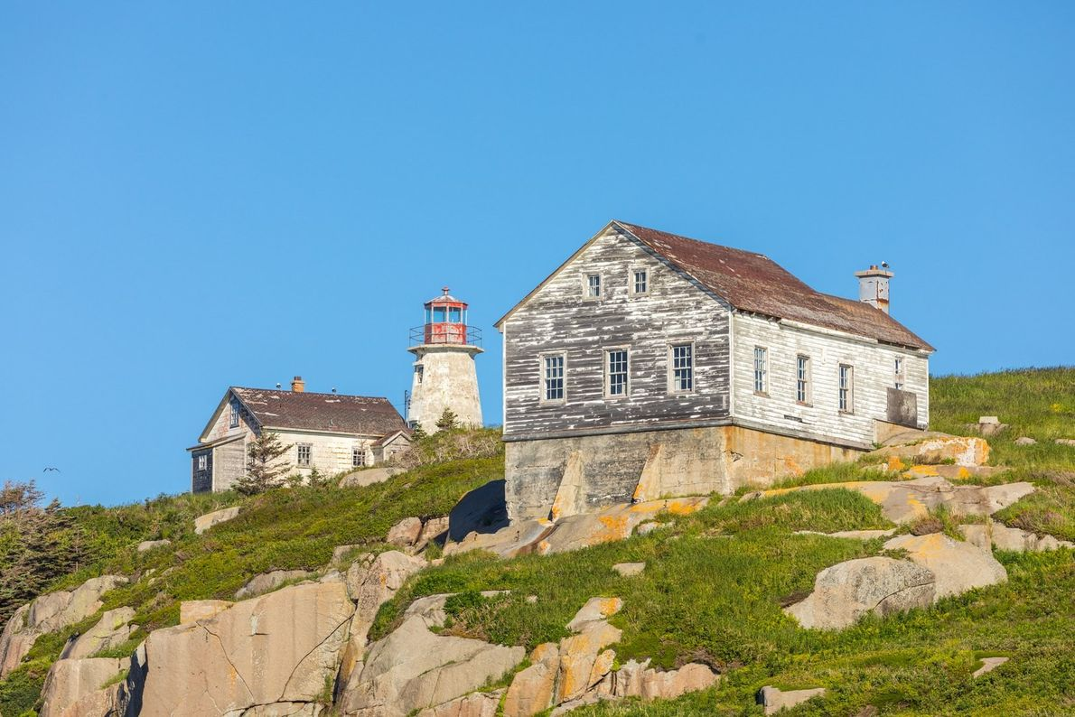 Built in 1875, the abandoned Ile du Corossol lighthouse remains on the Corossol Island Migratory Bird ...
