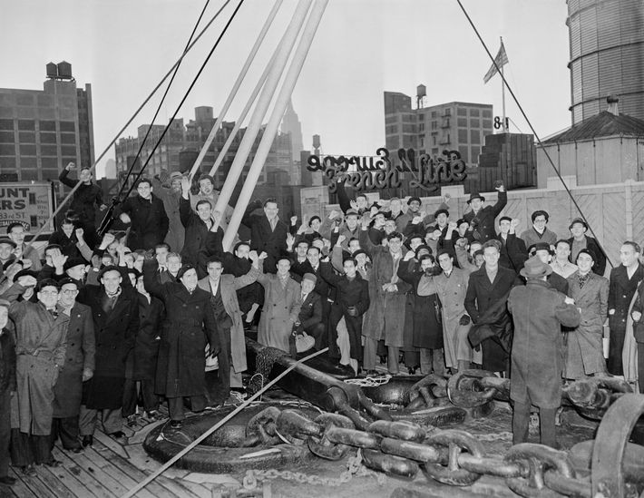 Members of the Abraham Lincoln Brigade celebrate their arrival in New York in 1938 after fighting ...