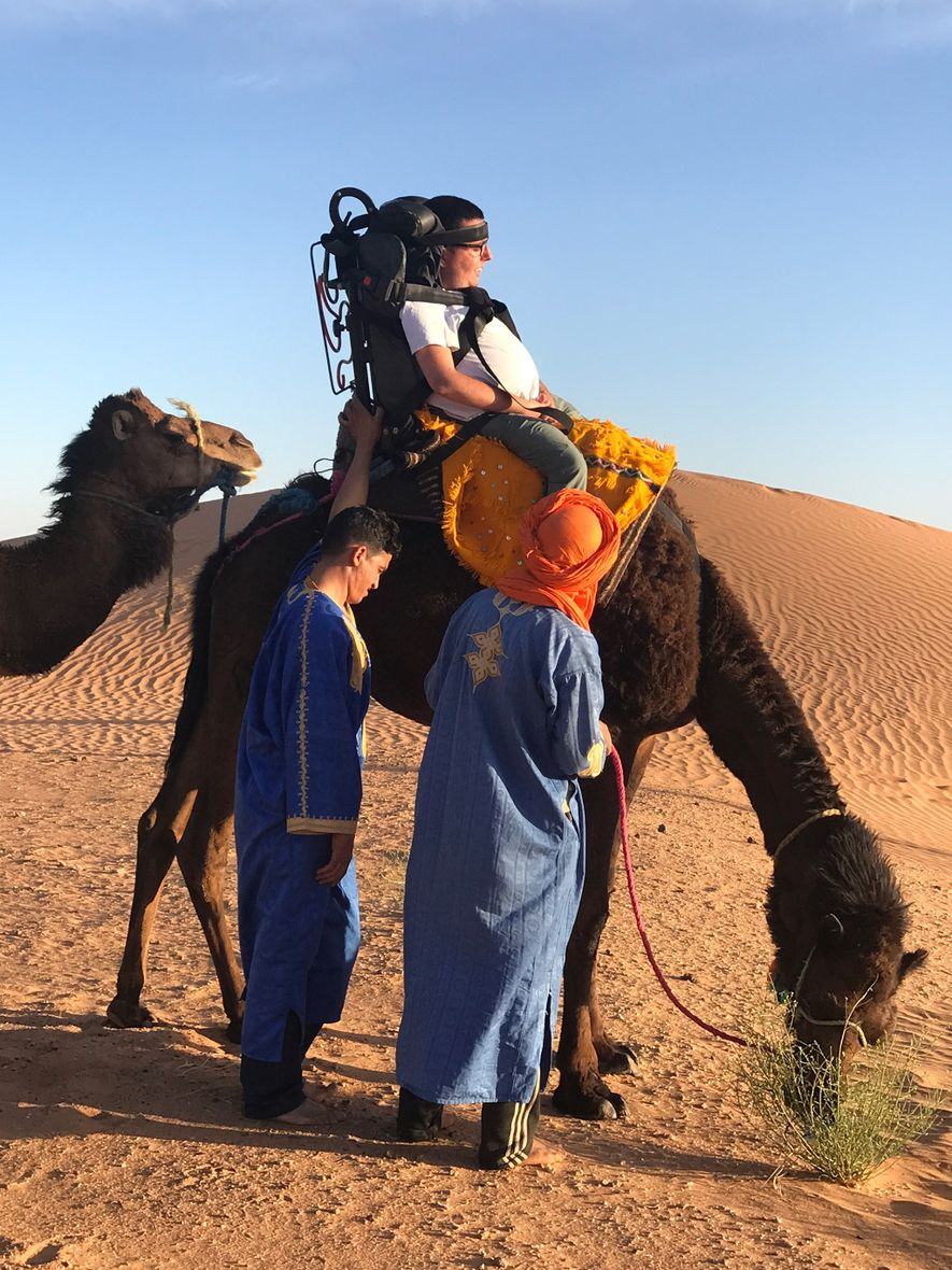 """""""It felt as if I was sitting in my wheelchair on top of the camel, surprisingly comfortable,"""" said writer Cory Lee Woodard. """"I'll never forget looking out and seeing the sand dunes as I rode the camel. It was a surreal moment for me."""""""