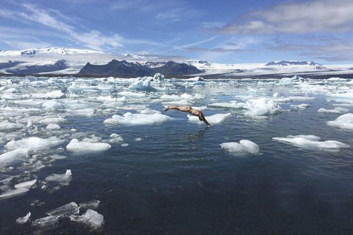 George Bullard taking a quick dip in polar waters. Image: George Bullard