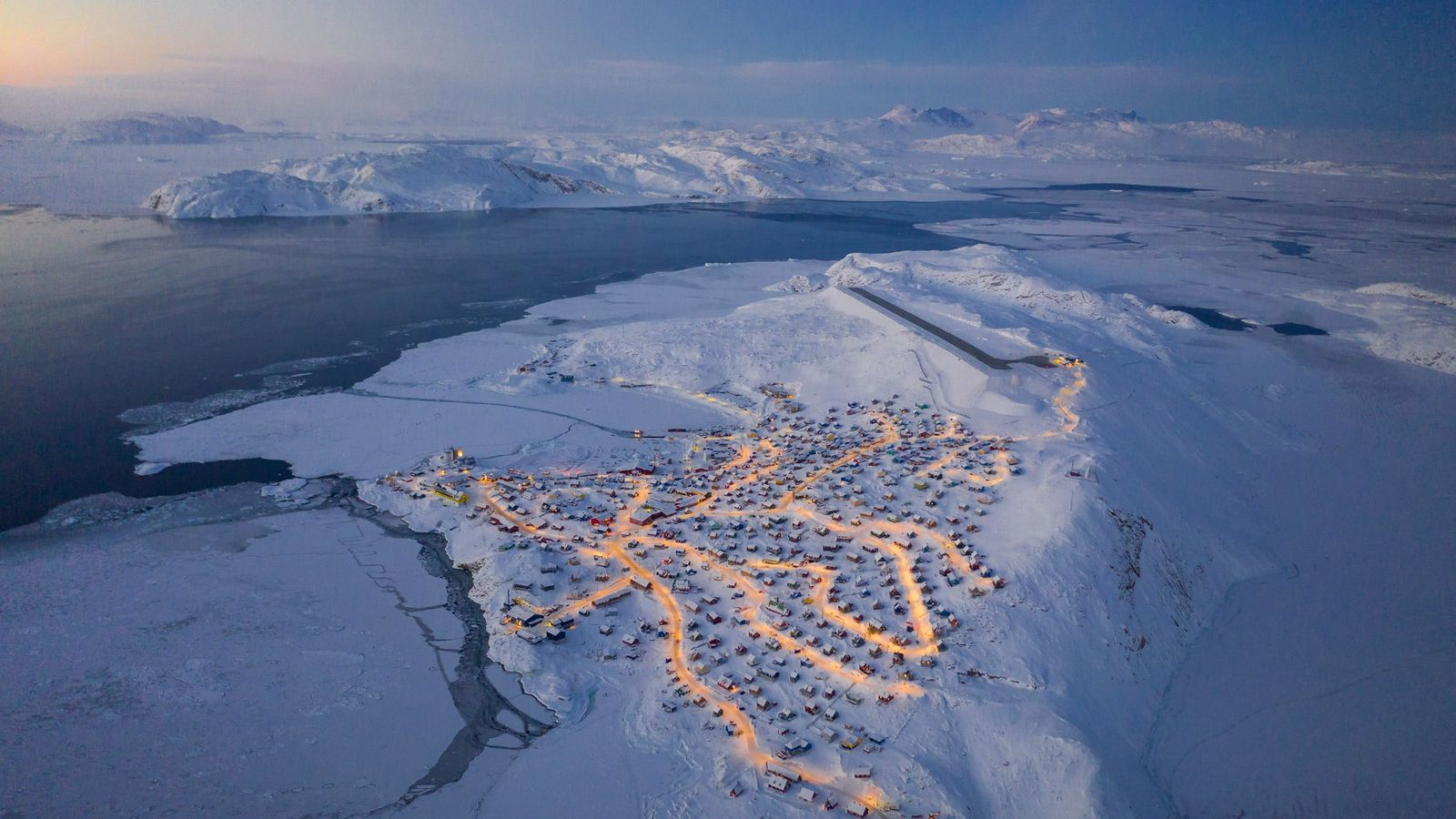 Chu hiked near the local airport for expansive views of Upernavik. When homes were lit in ...
