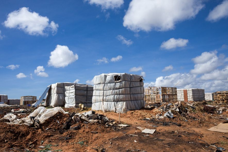Squared and bound like giant packing crates, these chabolas, shacks, are home to migrant workers who ...
