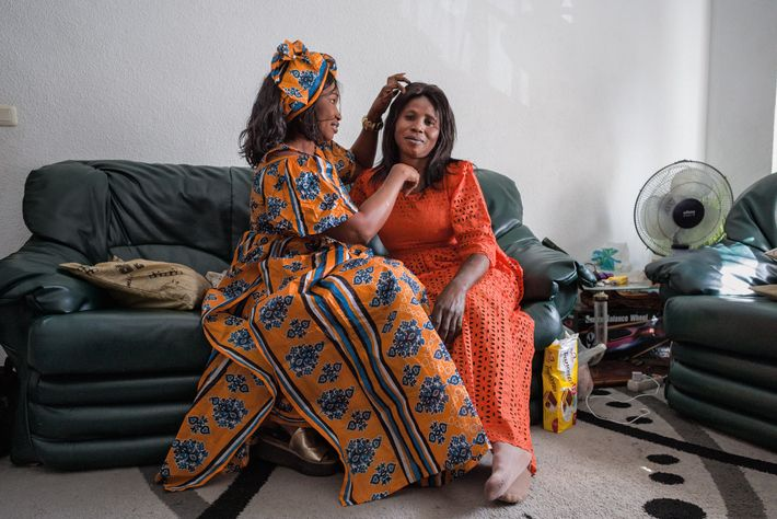 A decade into their new lives in Spain, Senegalese friends Fatou Ndoye, left, and Hawka Diallo ...