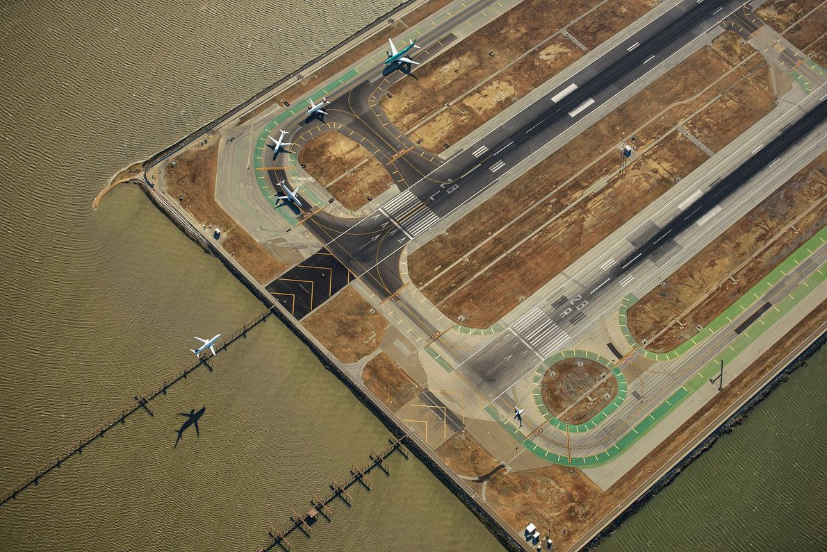 Airplanes are seen at San Francisco International Airport. There are four runways at the aiport, and ...