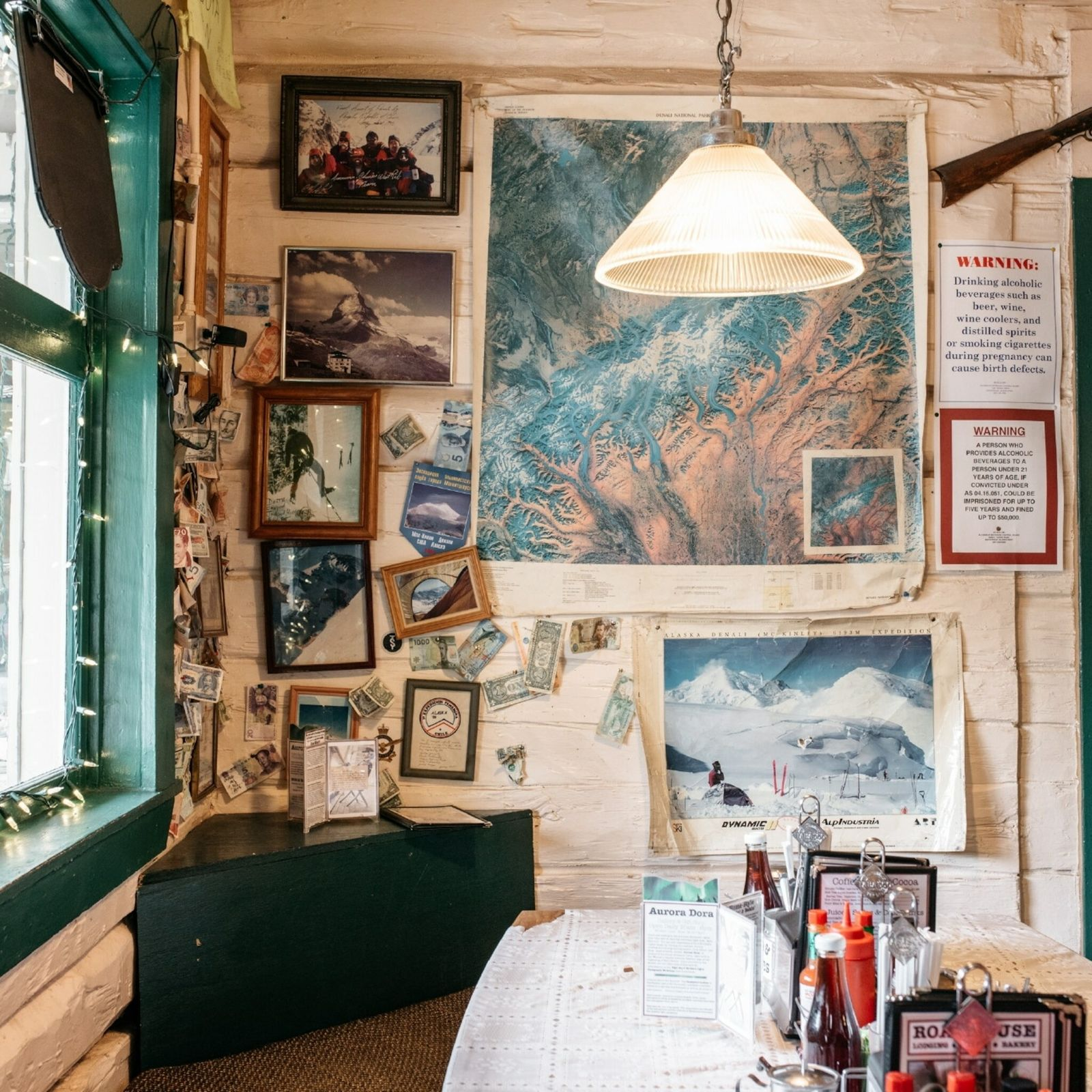 Inside the dining area of The Talkeetna Roadhouse. The open doorway leads to the cafe section ...