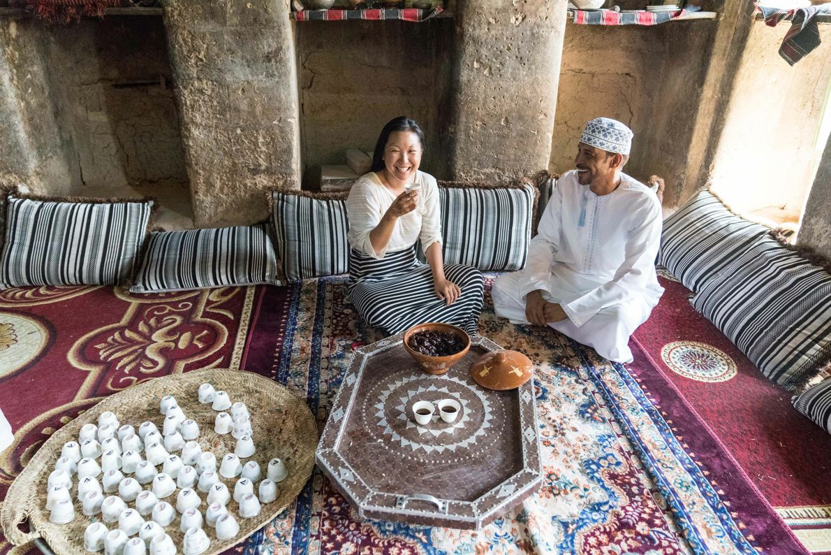 A villager in the 400-year-old town of Al Hamra in northeastern Oman shares his harvest of ...