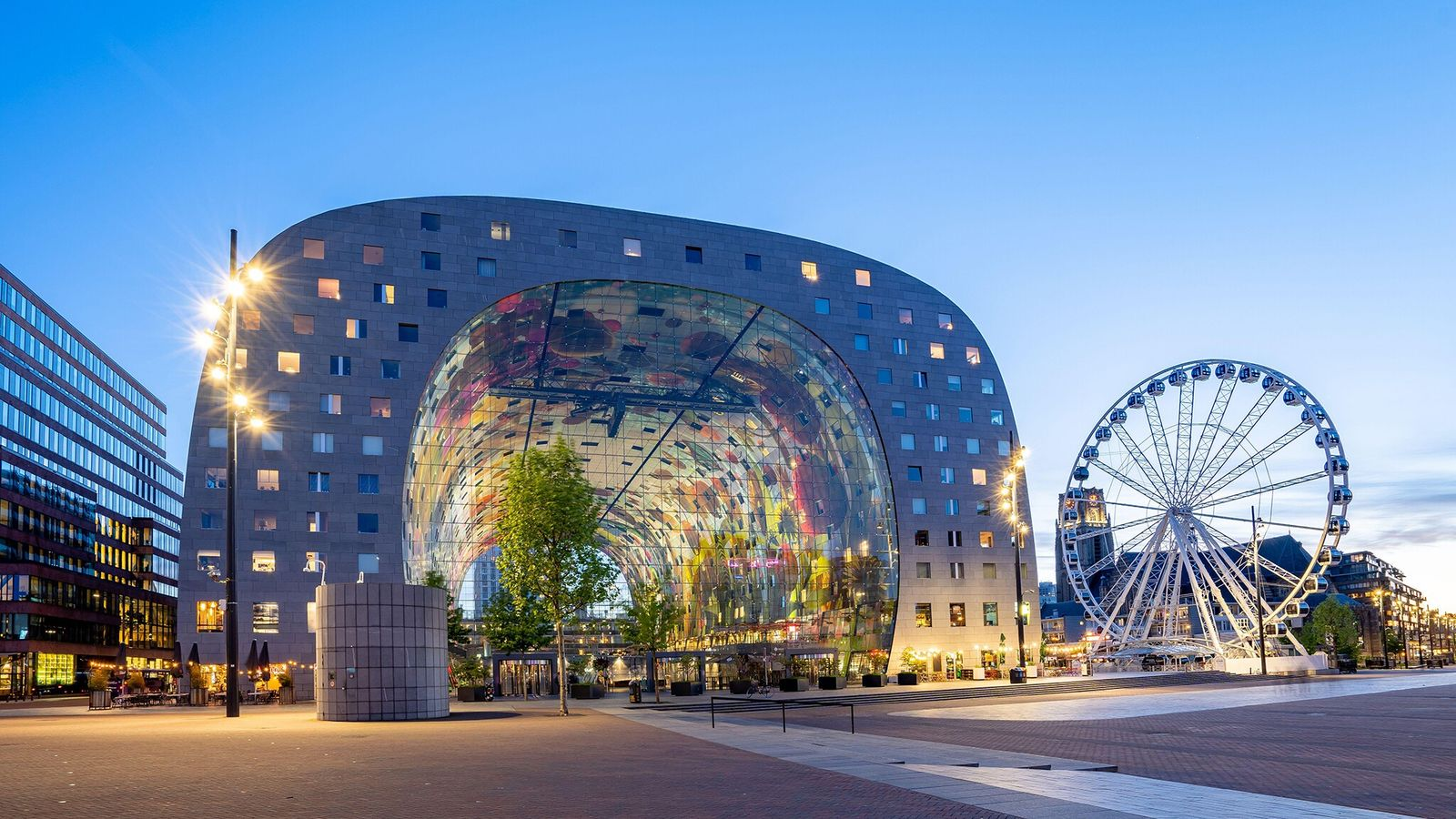 Markthal is a striking, horseshoe-shaped residential and dining complex whose food court dishes up a multicultural ...