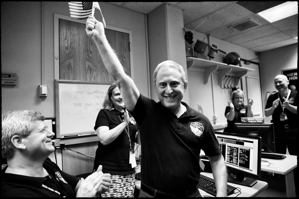 Alan Stern and the New Horizons team celebrate auspicious news: the spacecraft successfully flew through the ...