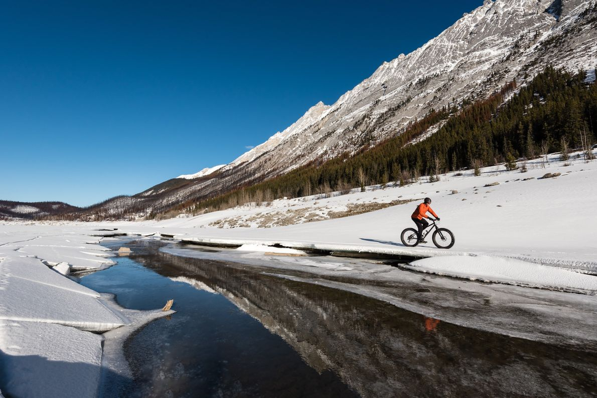Winter is a magical time for fat biking in Maligne Valley, Jasper National Park.