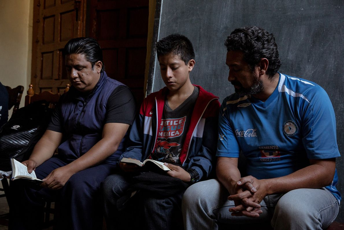 From left to right, Diego Reding, Ramón Moscoso, and Abelardo Cabañas practice reading the Liturgy of ...