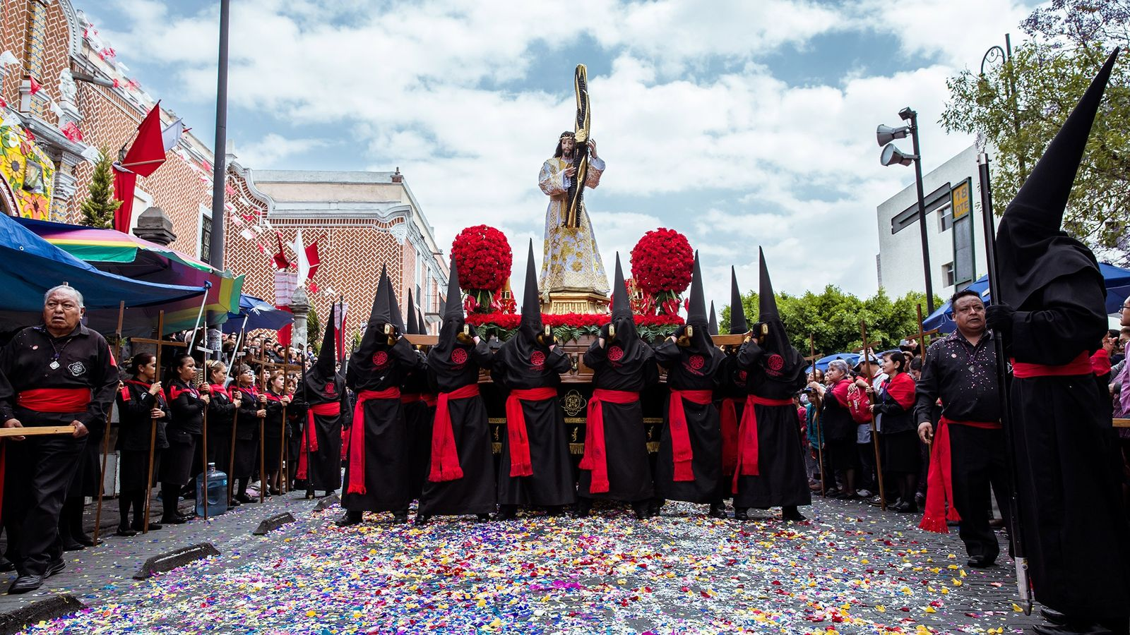 Members of the Brotherhood of Nazarenes carry the Jesus of Nazareth statue during the Holy Week ...