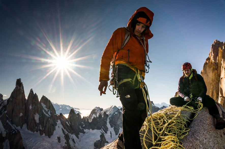 Tommy Caldwell (right) sets up a rappel on the way to Aguja Saint Exupery, one of ...