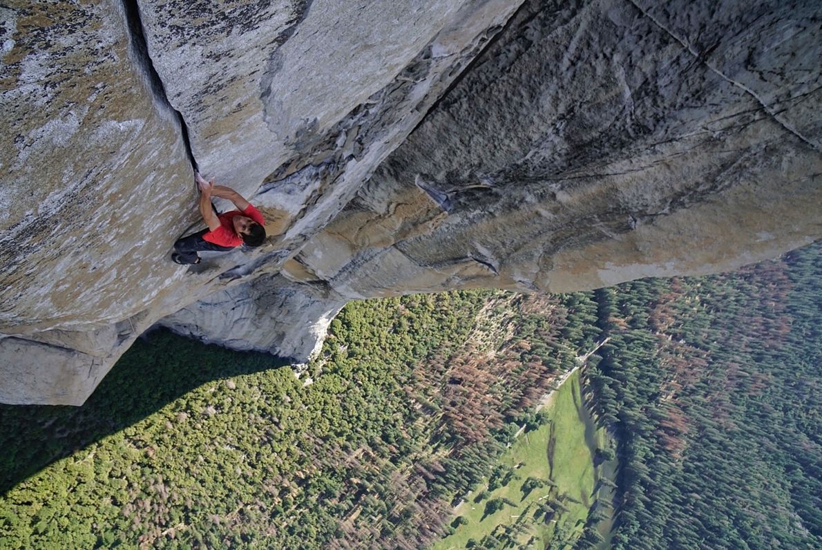 Honnold climbs without a rope 700 metres (2,000 feet) above the ground, on a pitch called ...