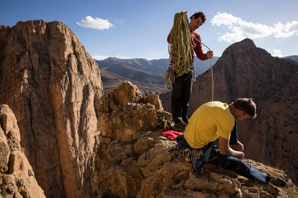 Honnold and partner Tommy Caldwell eat, hydrate, coil the rope, and pack their gear during an ...