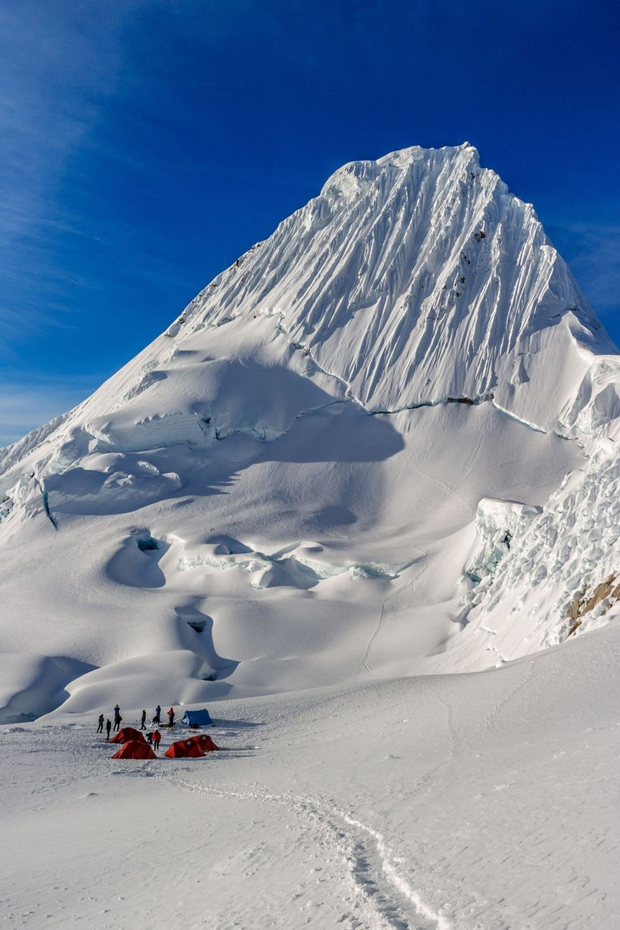 Often described as the most beautiful mountain in the world, Alpamayo is a soaring shark's fin ...
