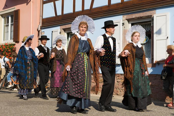 The Alsace bonnet is a flamboyant, winged creation in black velvet, worn a festivals throughout the region.