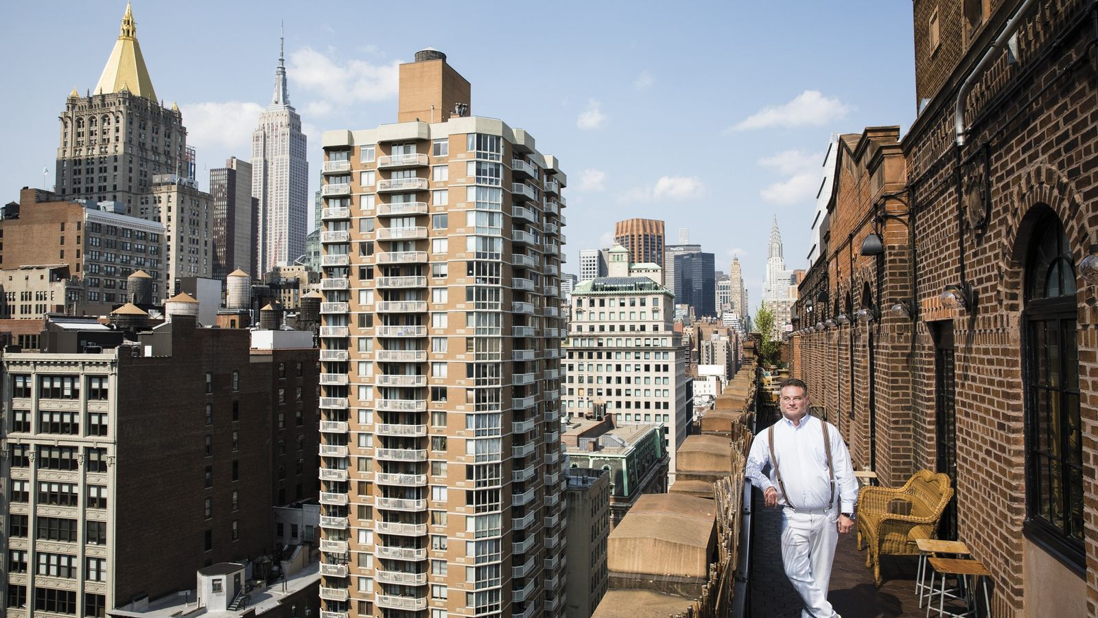 Andrew Zobler looks out on New York City from the roof of his Freehand Hotel, which ...