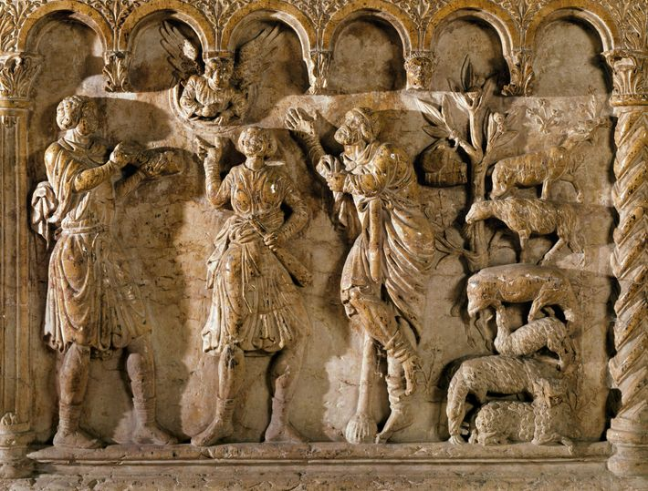 Shepherds listen to an angel announce Jesus' birth in a 12th-century relief from the Church of ...