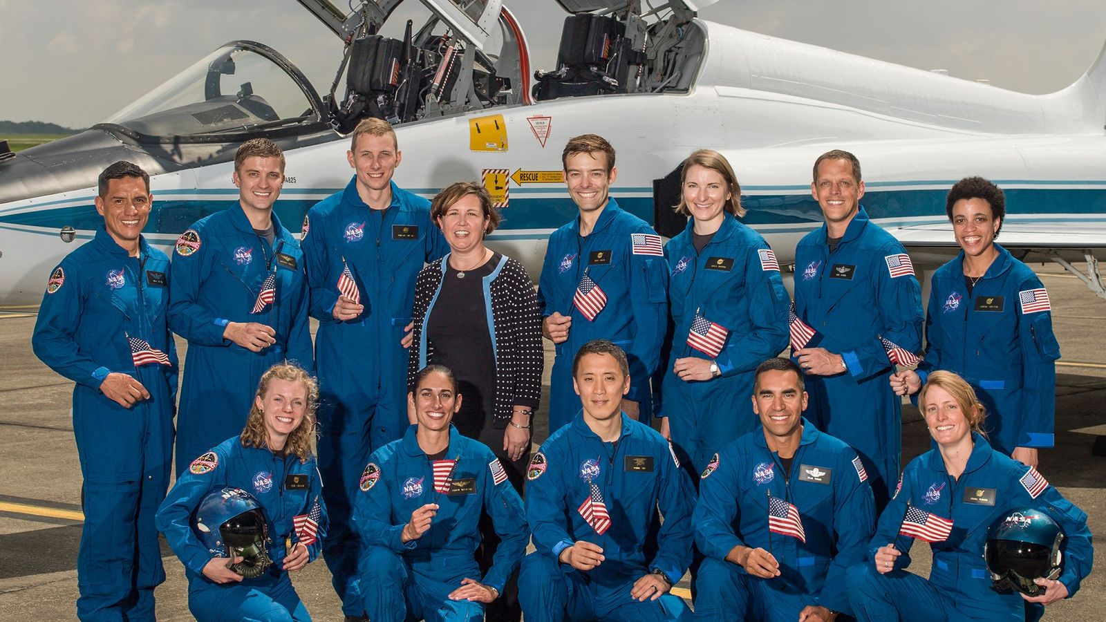 NASA's astronaut selection manager Anne Roemer stands with the most recent class of astronaut candidates selected ...